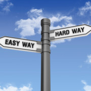 Directional Sign with EASY HARD WAY and Sky