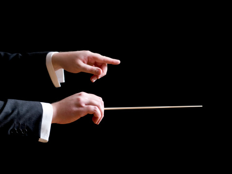 Music conductor pointing