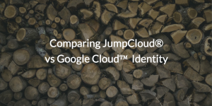 Comparing JumpCloud<sup>®</sup> vs Google Cloud™ Identity written over pile of mismatched wood