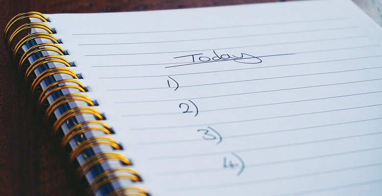 "An image of a notebook that says ""Today"" with a numbered list."