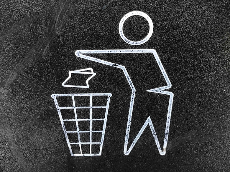 Chalk-type drawing of a person throwing trash in a waste bin.